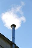 Chimney smoke of the heating system in winter Royalty Free Stock Photography