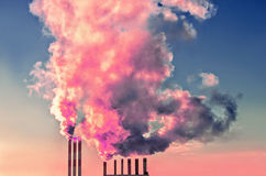 Chimney smoke at sky Stock Photo