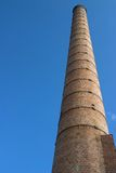Chimney / smoke stack at abandoned factory site Royalty Free Stock Photo
