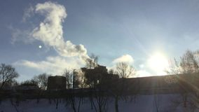 Chimney smoke in winter. Steam and smoke coming out of houses on bright sunny winter day stock footage