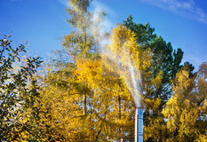 Chimney smokes in autumn Royalty Free Stock Images