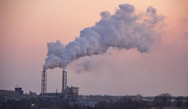 Chimney smoking stack. Air pollution and climate change theme. stock image