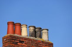 Chimney stack against a clear blue sky stock photo