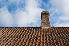 Chimney stack on red tile roof Royalty Free Stock Photos