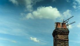 Chimney Stack with Television Aerials on House - Jul 2014. Royalty Free Stock Photo
