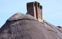Chimney stack on thatch roof Royalty Free Stock Photos