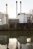 Chimney Stacks and Storage Tanks. Stock Image