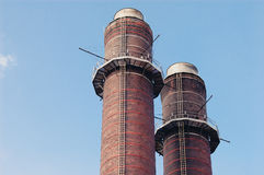 Chimney-stalk against blue sky Stock Images