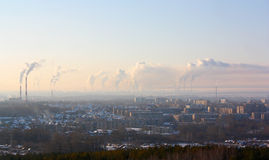 Chimney-stalks pollute atmosphere. Smoke on the city Royalty Free Stock Photos