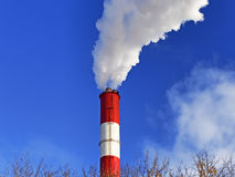 Chimney with steam production of a thermal power station Royalty Free Stock Images