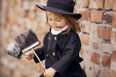 Chimney Sweep Girl. Girl as a chimney sweep against brick wall Stock Photos