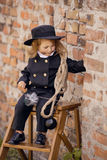 Chimney Sweep Girl. Girl as a chimney sweep against brick wall Stock Photo