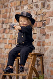 Chimney Sweep Girl. Girl as a chimney sweep against brick wall Stock Image