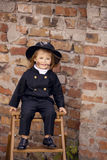 Chimney Sweep Girl. Girl as a chimney sweep against brick wall Stock Images