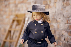 Chimney Sweep Girl. Girl as a chimney sweep against brick wall Stock Photography