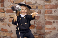 Chimney Sweep Girl. Girl as a chimney sweep against brick wall Royalty Free Stock Photo