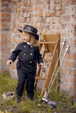 Chimney Sweep Girl. Girl as a chimney sweep against brick wall Royalty Free Stock Photos
