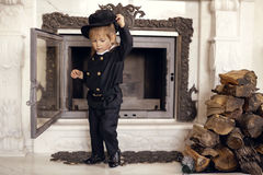 Chimney Sweep Playful Girl. Girl as a chimney sweep against fireplace. Lucky New Year's Eve and New Year Stock Images