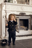 Chimney Sweep Playful Girl. Girl as a chimney sweep against fireplace. Lucky New Year's Eve and New Year Royalty Free Stock Image