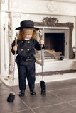 Chimney Sweep Playful Girl. Girl as a chimney sweep against fireplace. Lucky New Year's Eve and New Year Stock Image