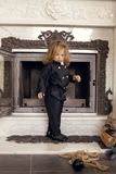 Chimney Sweep Playful Girl. Girl as a chimney sweep against fireplace. Lucky New Year's Eve and New Year Royalty Free Stock Photos