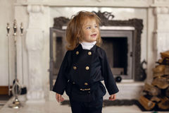 Chimney Sweep Playful Girl. Girl as a chimney sweep against fireplace. Lucky New Year's Eve and New Year Royalty Free Stock Photography