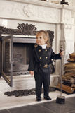 Chimney Sweep Playful Girl. Girl as a chimney sweep against fireplace. Lucky New Year's Eve and New Year Royalty Free Stock Images
