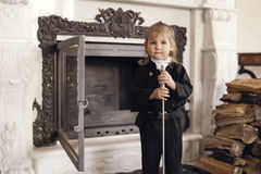 Chimney Sweep Playful Girl. Girl as a chimney sweep against fireplace. Lucky New Year's Eve and New Year Stock Photography