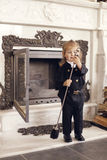 Chimney Sweep Playful Girl. Girl as a chimney sweep against fireplace. Lucky New Year's Eve and New Year Stock Photos