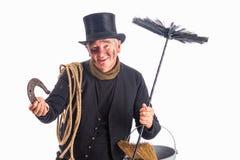 Chimney sweep wishing good fortune. New Year photo of a chimney sweep wishing good fortune with a horseshoe Stock Image