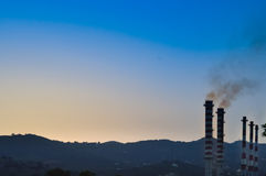 Chimney of a thermoelectric power station Royalty Free Stock Image