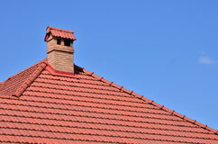 Chimney on tile roof Royalty Free Stock Image