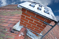 Chimney on tiled roof Stock Image