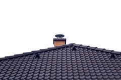 Chimney on tiled roof with isolated sky Royalty Free Stock Photo