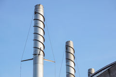 Chimney tower .Thermal power stations and power lines. Royalty Free Stock Images