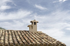 Chimney. Traditional chimney and tiled roof in a village in Castile, Spain Stock Image