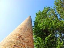 Chimney and tree on blue sky Stock Photo