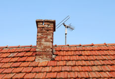 Chimney and TV antenna Royalty Free Stock Photo