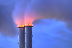 Chimney Twins. Chimneys release steam at dawn Royalty Free Stock Images
