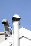 Chimney and ventilation pipe Stock Images