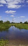 Chimney in water relflection Stock Photo