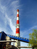 Chimney, wharf, pipelines, tree and sky Stock Images