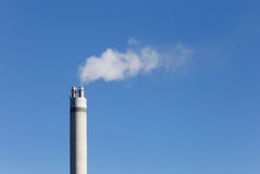 Chimney with white smoke Royalty Free Stock Images