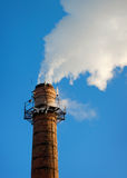 Chimney with white vapor Royalty Free Stock Photo