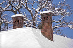 Chimney in winter Stock Photography