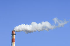 Chimney with withe Smokestack against a blue sky, Beijing, China Royalty Free Stock Photography