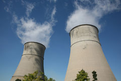 Chimneys. Two grey power station chimneys royalty free stock images