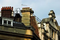 Chimneys. English style colourful chimneys on a roof Royalty Free Stock Images