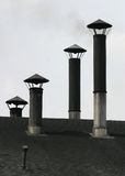 Chimneys. On a workshop roof Stock Images