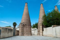 The chimneys of the ancient Cartuja monastery where the artistic tiles were once worked Stock Photo